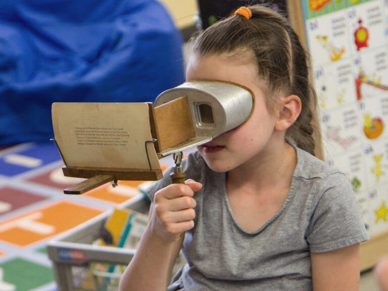 Student with photo viewer