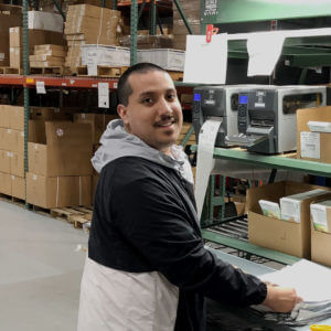 Person smiling at warehouse mail counter