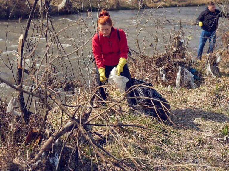 Volunteers clean a riverfront