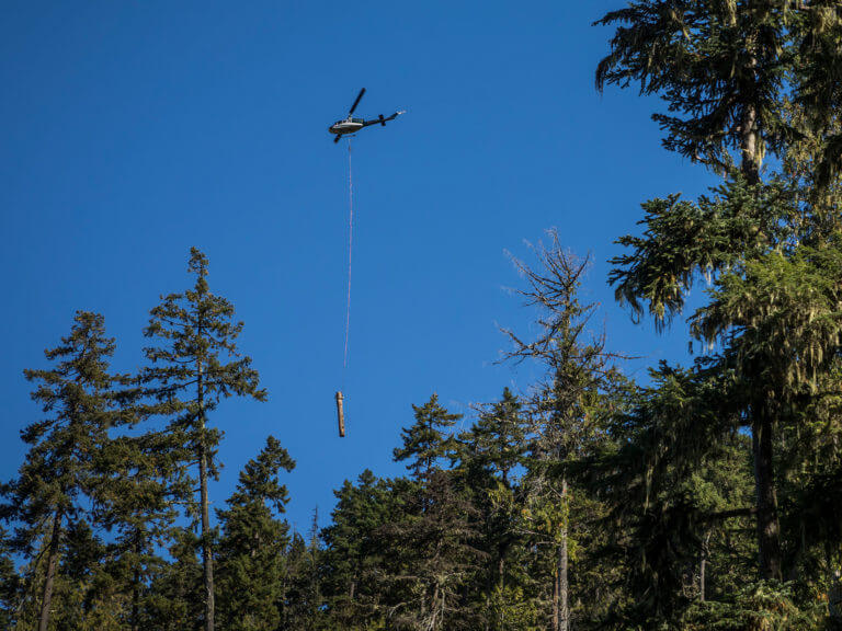 A helicopter moving a log