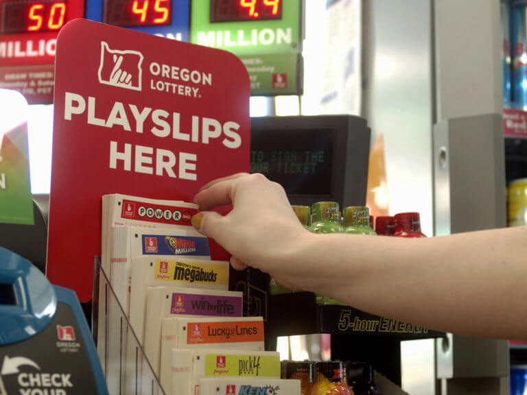 hand reaching for playslip at convenience store counter