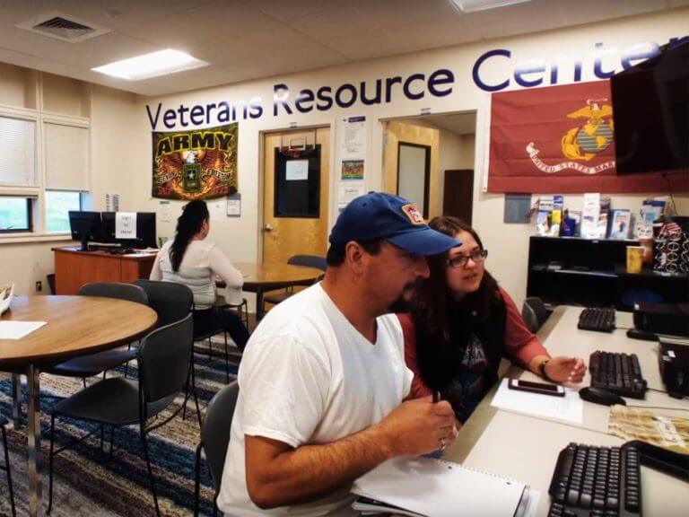 Student veteran using a laptop